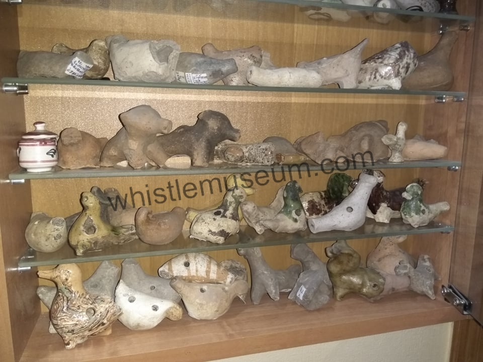 This image has an empty alt attribute; its file name is Cabinet-of-very-old-Russian-Clay-Pottery-Whistles-collection-of-M-O.jpg